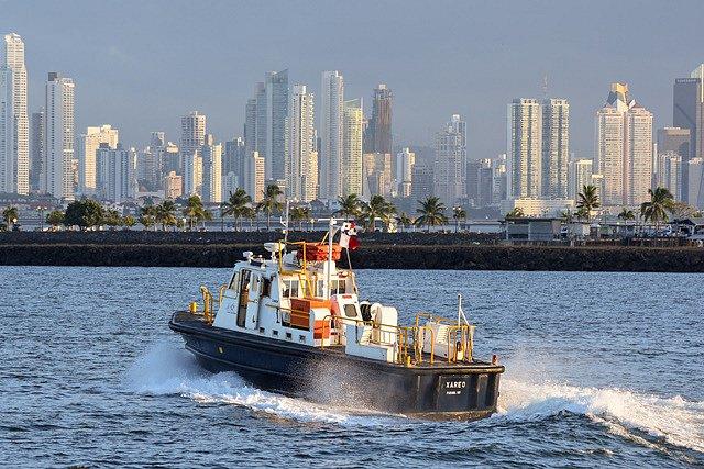 Canal tug and Panama City skyline