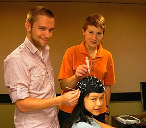 Students fitting colleague with the EEG head cap