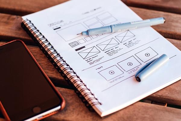Notebook, pen, phone