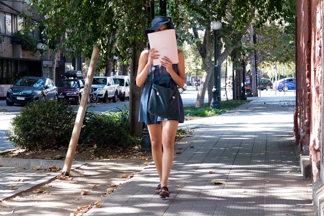 Woman walking and reading