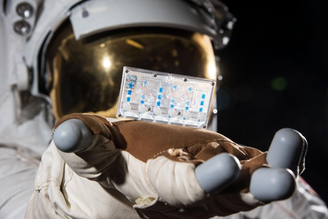 Astronaut with tissue chip